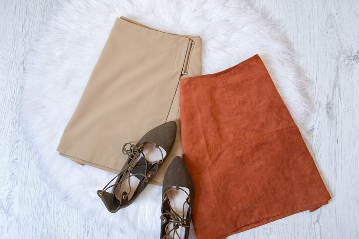 Brown and beige suede skirt, brown shoes. Fashionable concept.